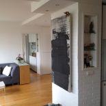 Luxusní designový radiátor Granit z Olycale kamene - v interiéru